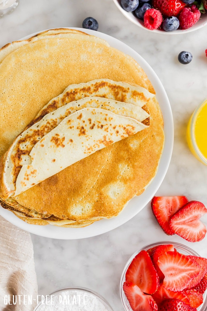 a plate full of gluten free crepes with no filling