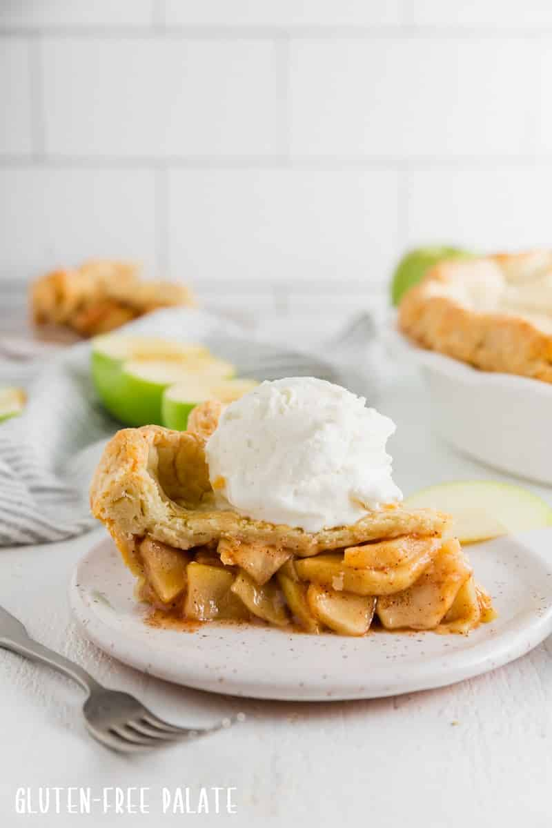 a slice of gluten free apple pie with a scoop of ice cream