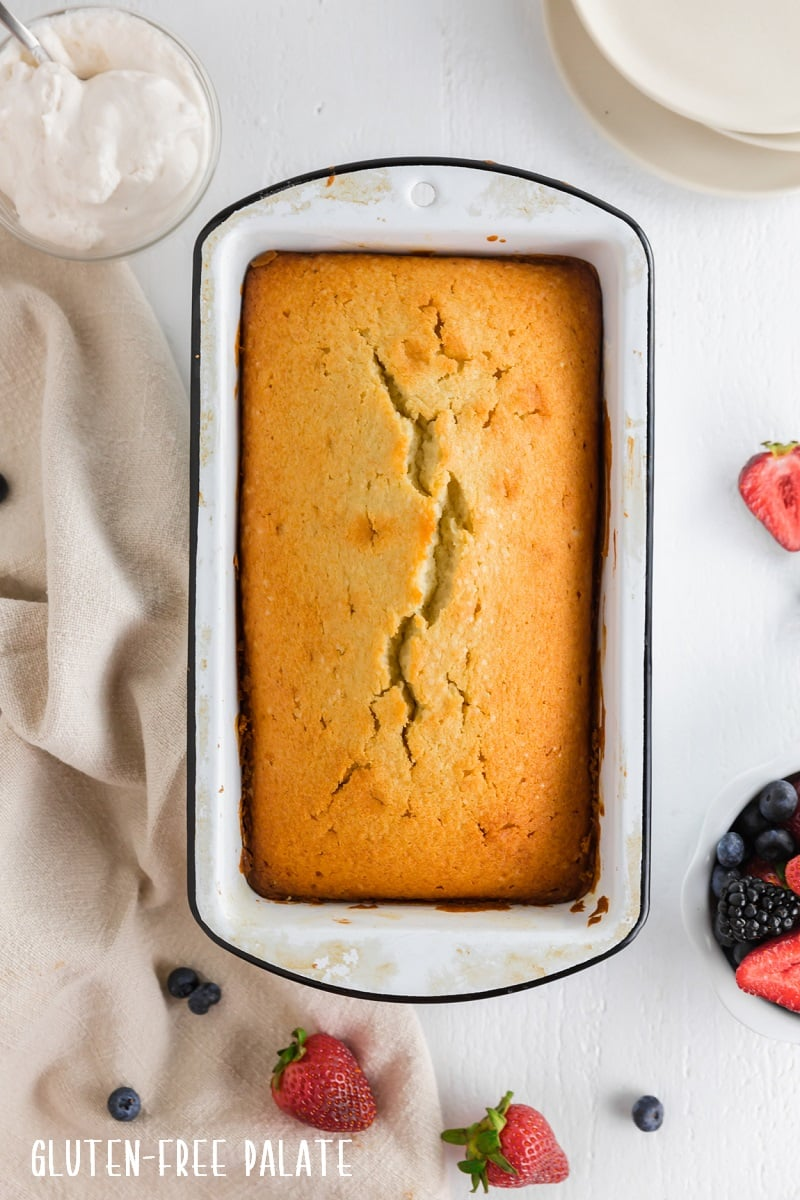top down view of gluten free pound cake in a white baking pan