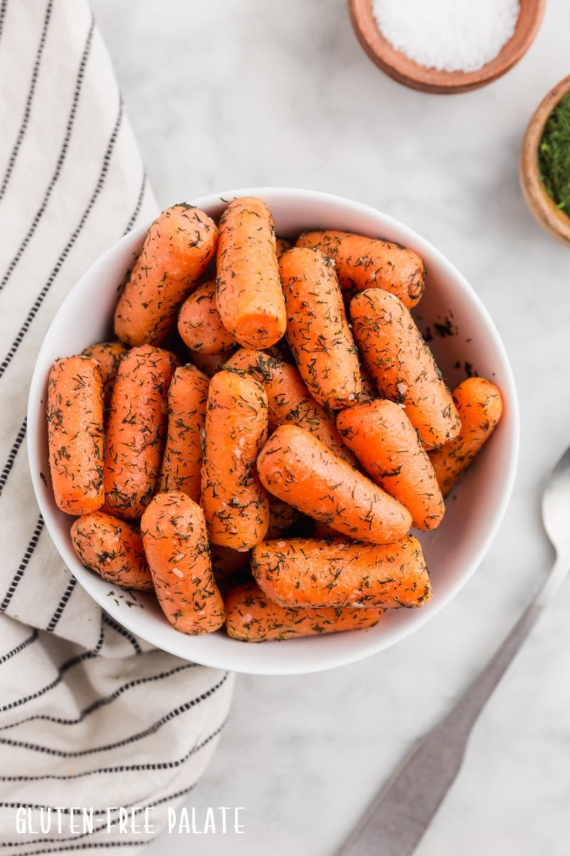 top down view of cooked instant pot carrots in a white bowl