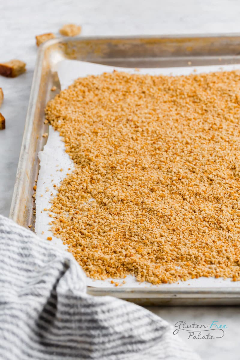 a side view of gluten free breadcrumbs on a baking sheet
