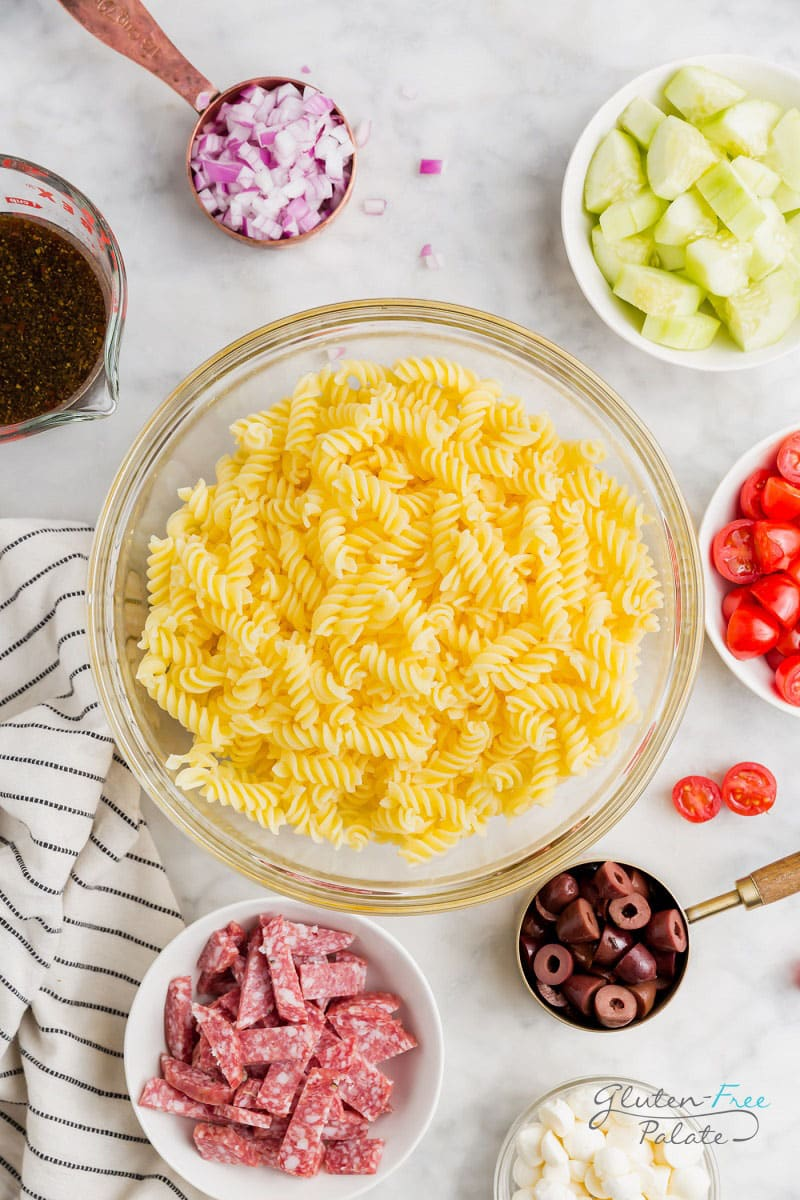 a top down view of ingredients in pasta salad