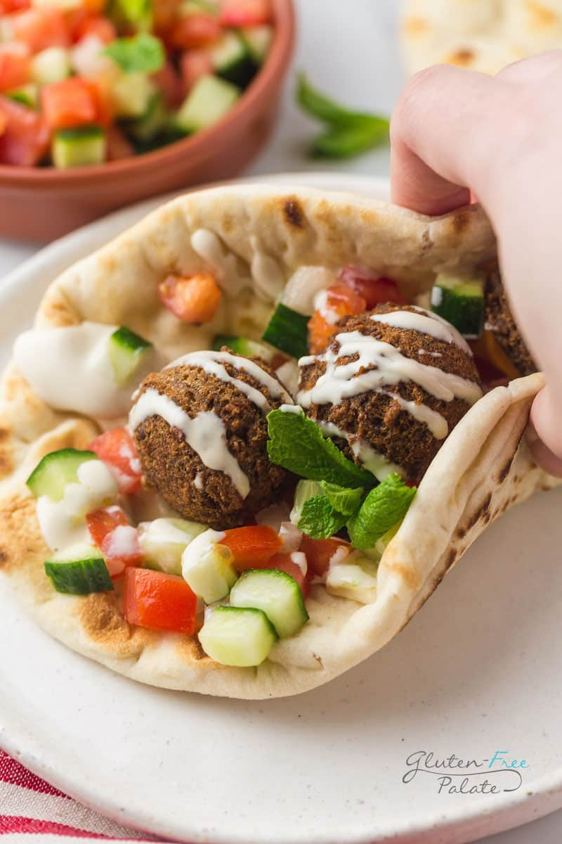 gluten free falafel wrap topped with tahini sauce
