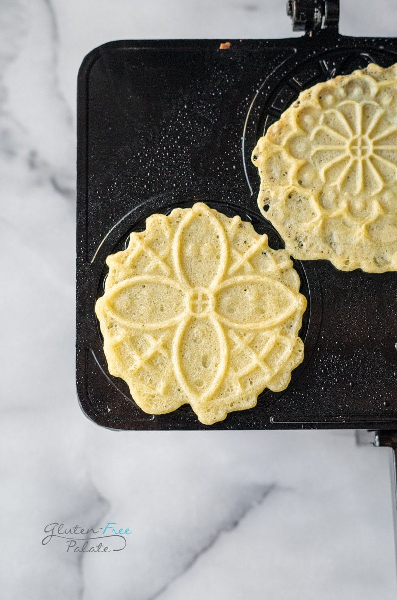 gluten free pizzelle on a pizzelle iron