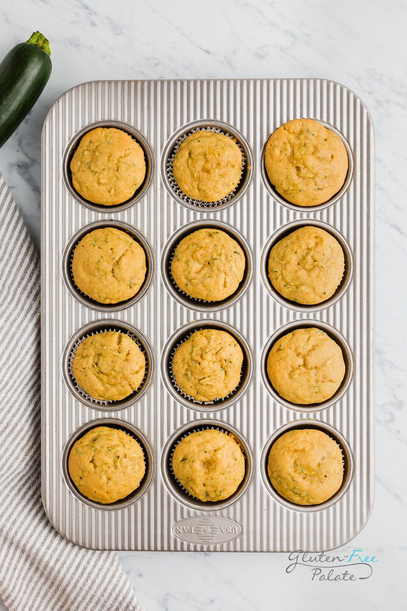 top down view of gluten free zucchini muffins in a muffin baking pan