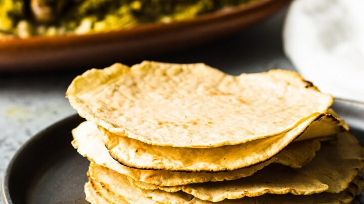 a stack of gluten free corn tortillas on a black plate