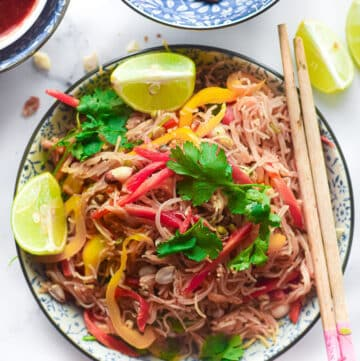 gluten free pad thai on a plate with chop sticks