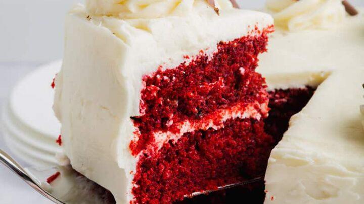 a slice of gluten free red velvet cake on a serving knife