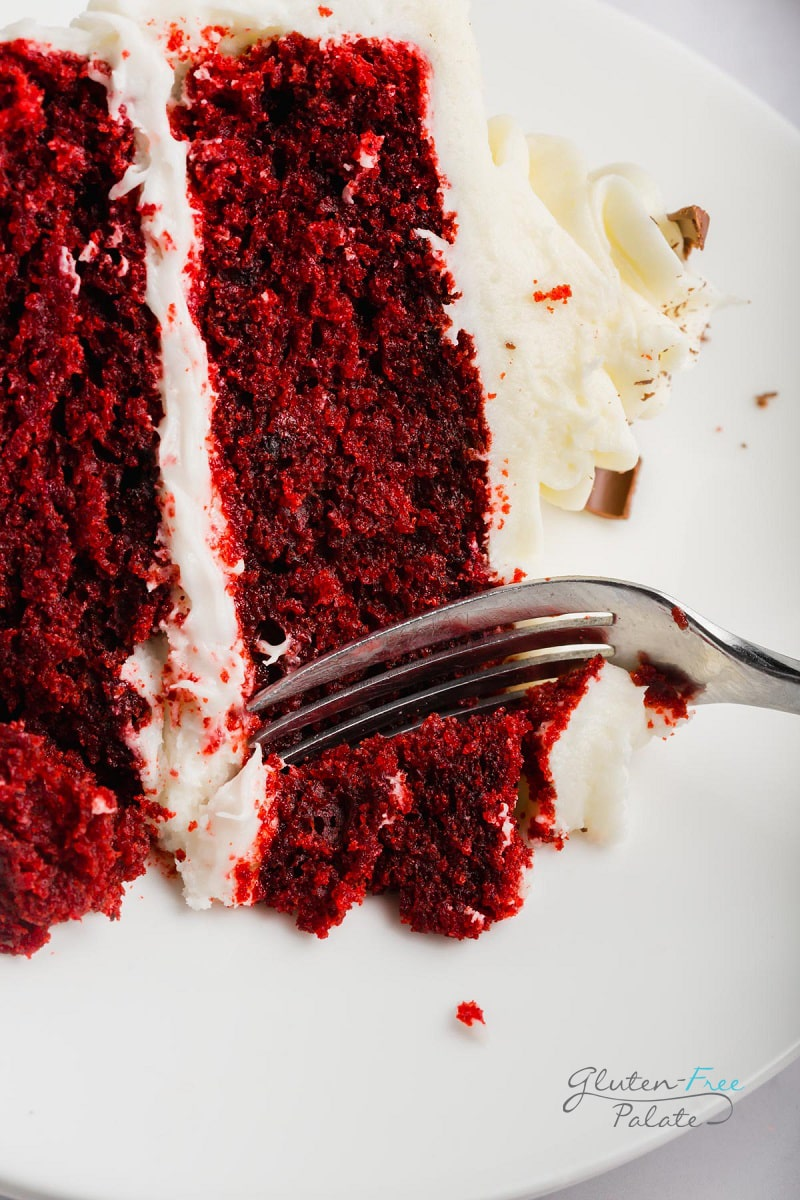 a close up of gluten free red velvet cake with a fork