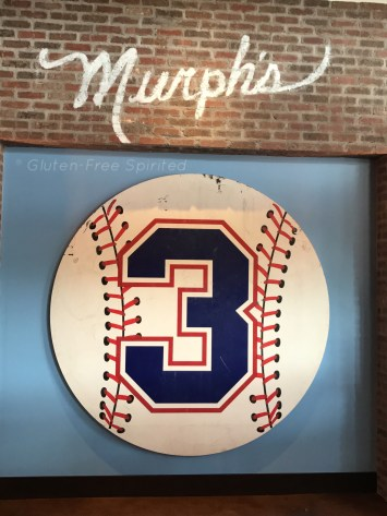 A picture of a giant baseball sign with a #3.