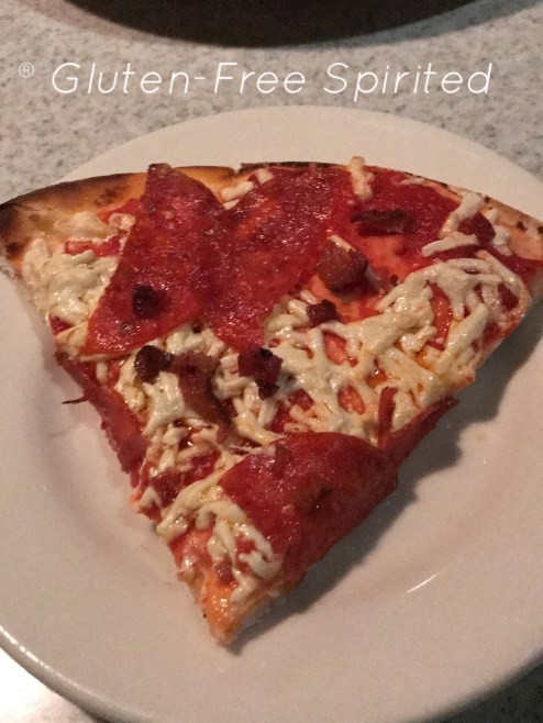 A slice of pepperoni & bacon pizza from Brixx Pizza