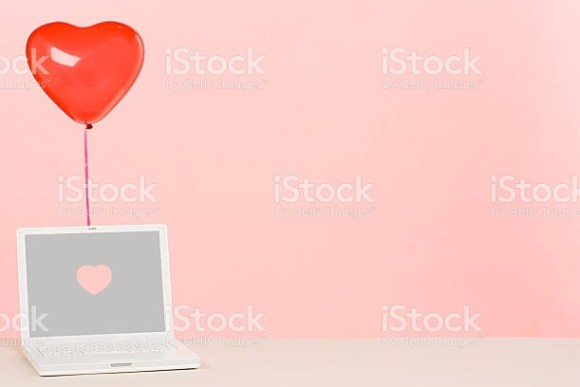 Laptop under love heart