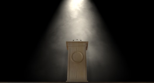Spotlit Press Podium by Albund (Dreamstime)