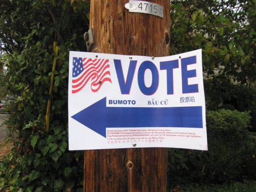 Sign pointing to polling place - Vote