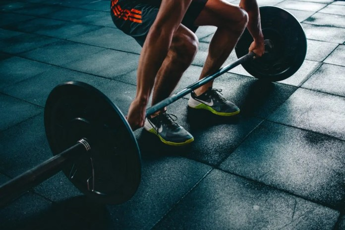 person holding barbell