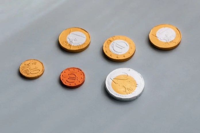 photo of chocolate coins on top of grey table