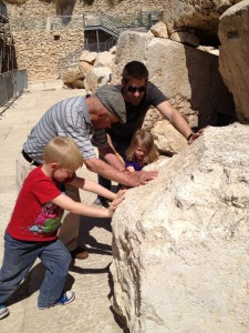 Trying to move the huge rock that once made up part of the old city walls