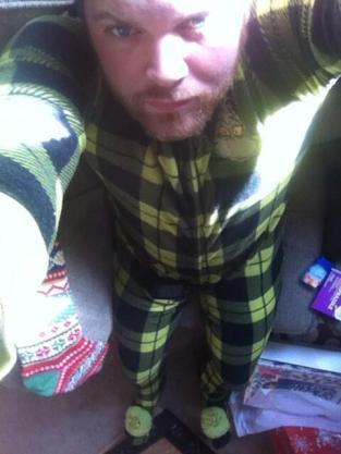 Poor bastard got a Grinch onesie for Christmas! (Nate Smith/Twitter)