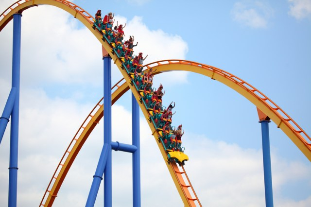 People riding a rollercoaster in an amusement park