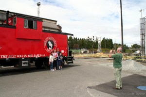 Posing for photos in front of the beautiful GN painted caboose