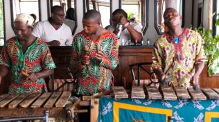 Local entertainers using wooden xylophone.