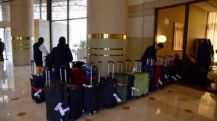 Baggage being sorted prior to delivery to our rooms