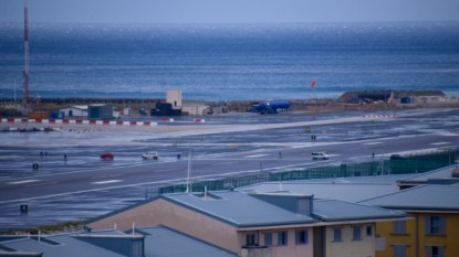Notice the car crossing the airport runway