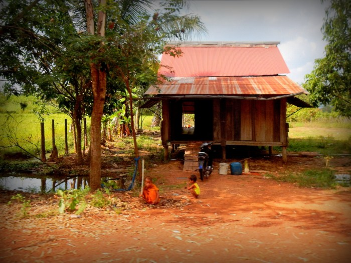 Cambodian children outside their home