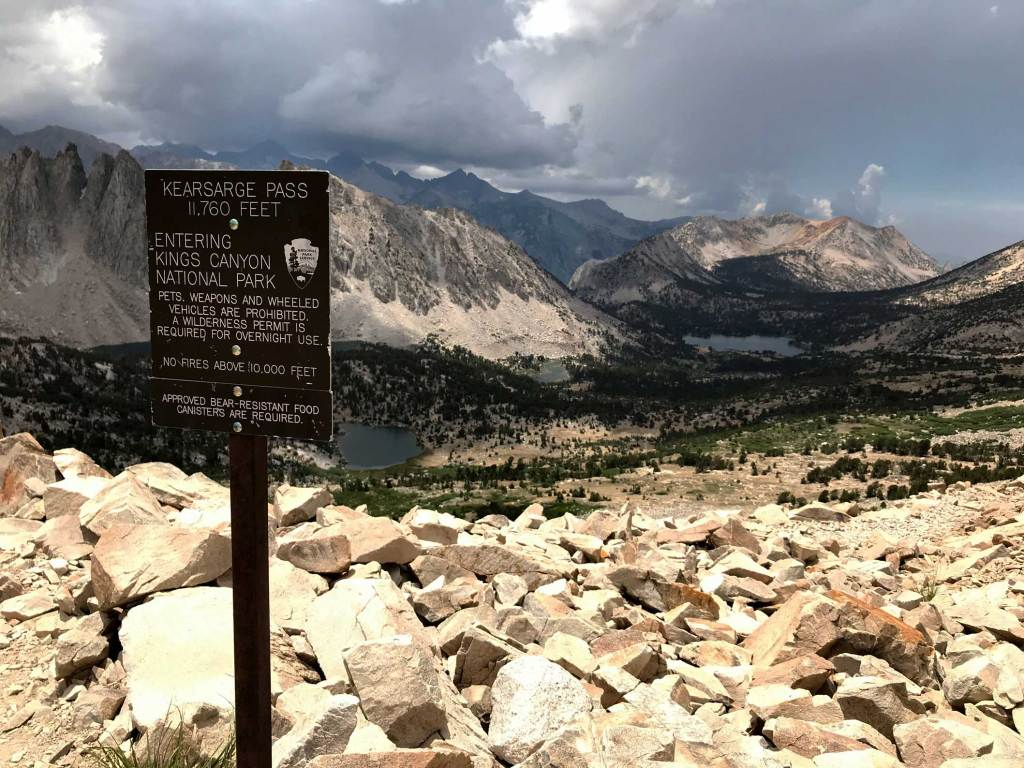 Watching an approaching storm atop Kearsarge Pass