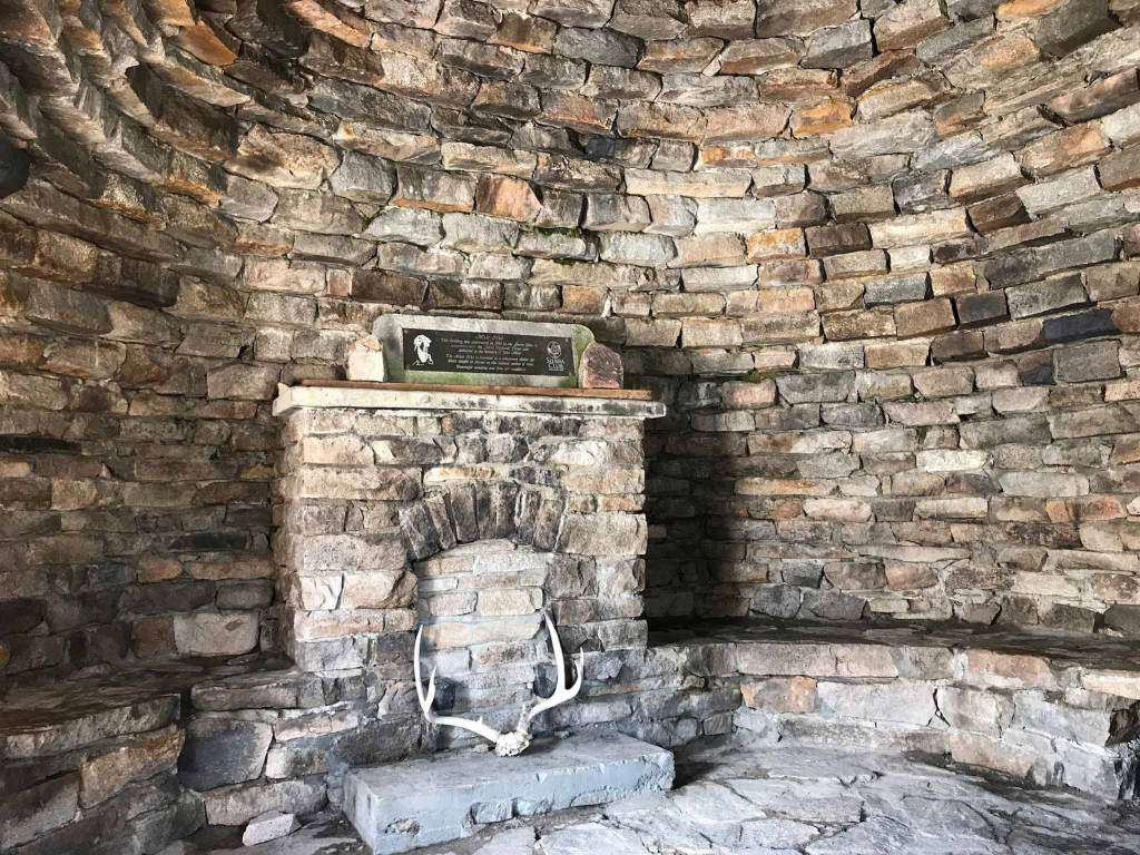 A stone fireplace inside Muir Hut provides a sense of homeliness; however, it is merely there for decoration.