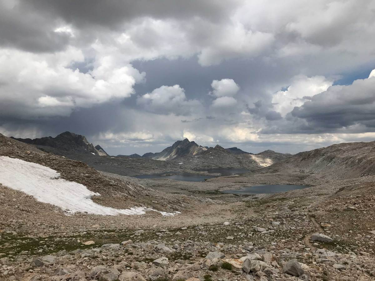 A storm approaches as we rest at the summit of Muir Pass