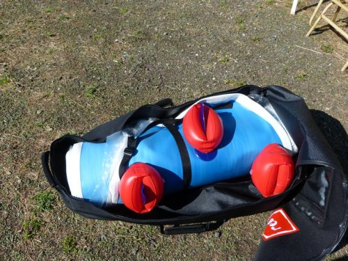 Kayak body rolled up in backpack