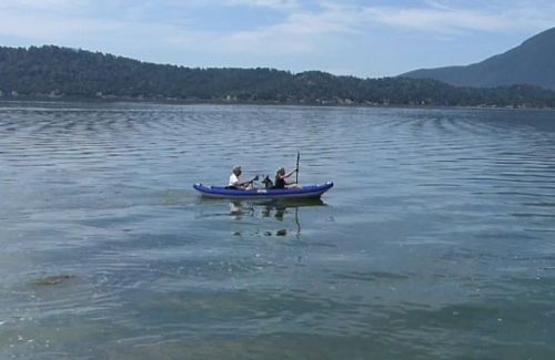Chinook Tandem inflatable kayak paddled by two with furry friend..