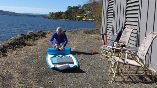 Rolling up the Red Air Sport 11 inflatable SUP