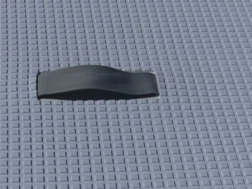 Traction pad and low profile carry handle