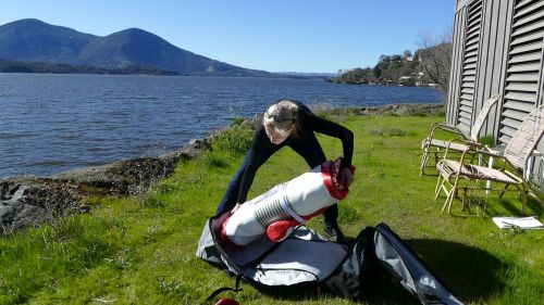 Rolling up the Hala Carbon Nass inflatable SUP