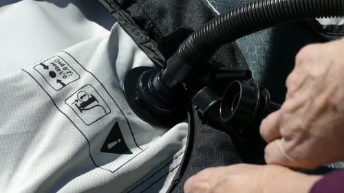 Attachig the pump hose to the valve.