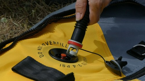 Attaching the pump to the kayak.