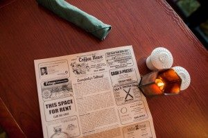 Coffee News newspaper on a table.