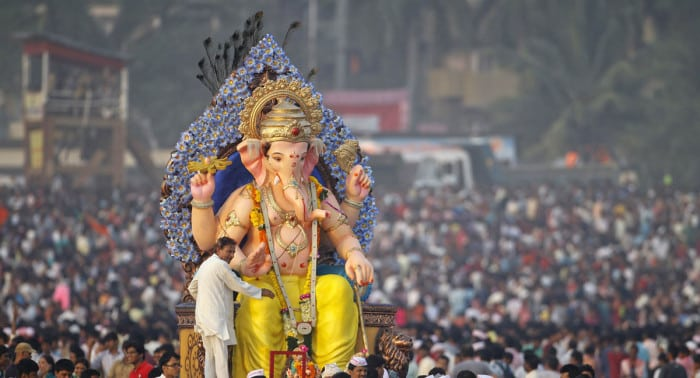 Devotees carry an idol of the Hindu elephant god Ganesh for immersion into the Arabian Sea on the last day of the Ganesh Chaturthi festival in Mumbai