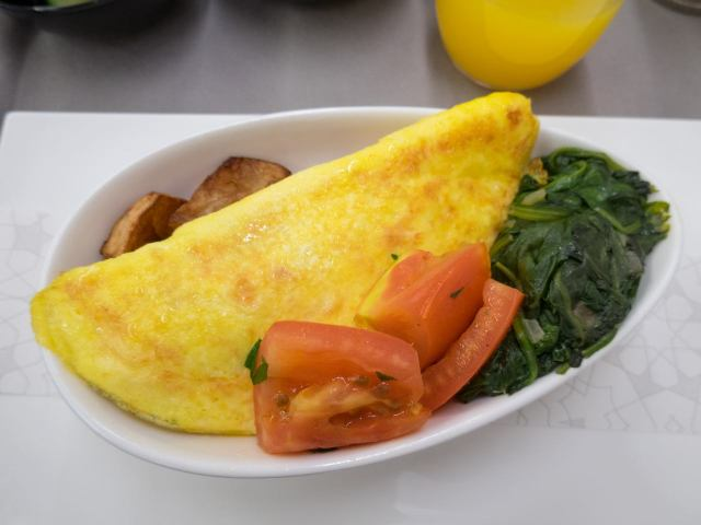 Omelet with potatoes, tomatoes and spinach