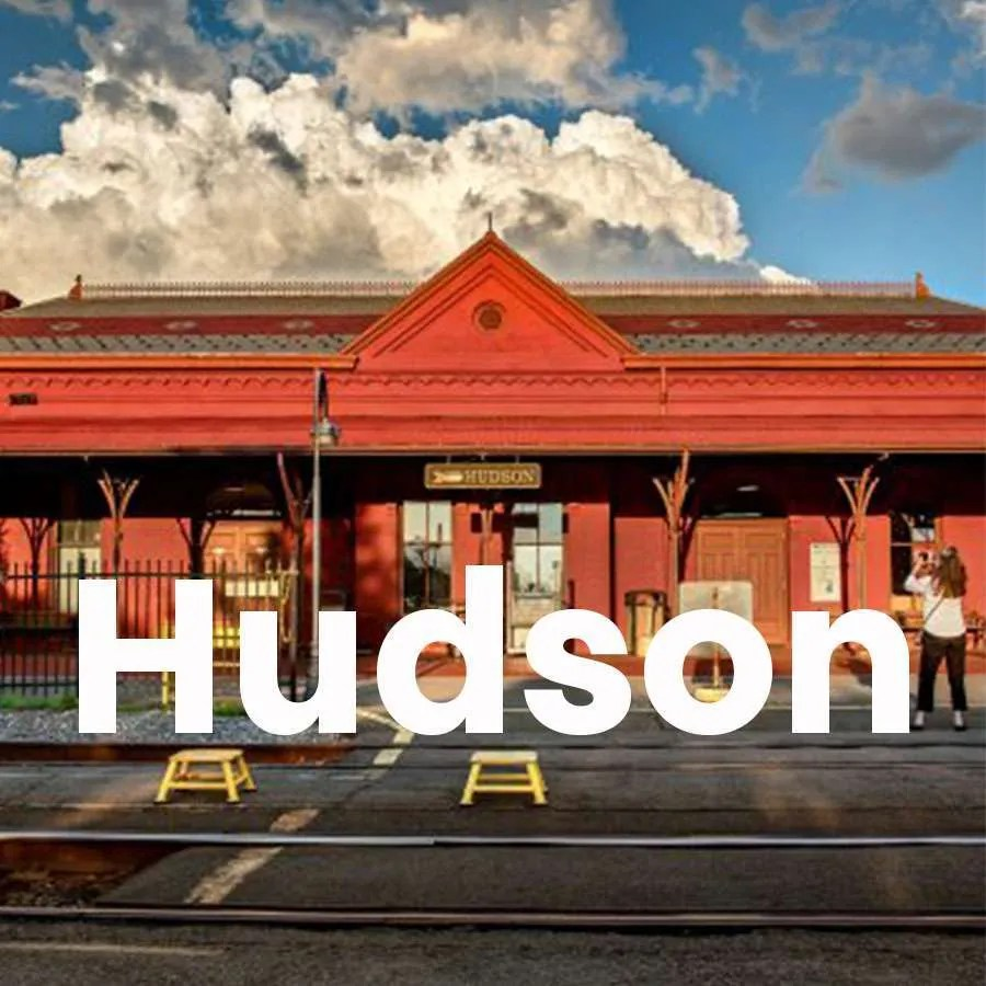 """Photo of the train station in Hudson with a super across the photo that says """"Hudson"""""""