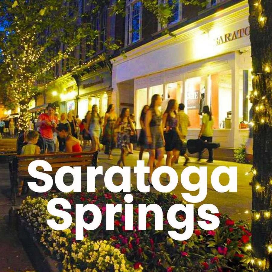 """Photo of people walking on Broadway in Downtown Saratoga Springs with a super across the photo that says """"Saratoga Springs"""""""