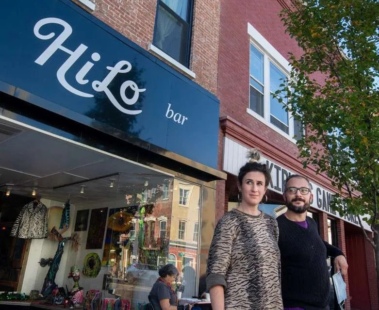 Laura and Liam Singer, Owners of HiLo in Catskill, stand in front of their café on Main Street.