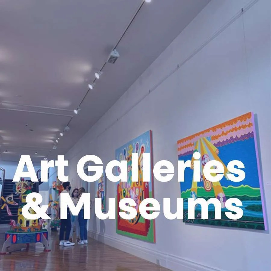 Photo of an art gallery wall which acts as a link to the page for Art Galleries & Museums