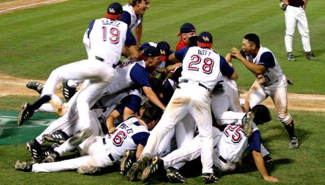 Dogpile after winning the 2003 Regional over A&M