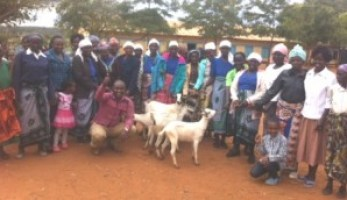 Ladies with donated goats pic 1 COM