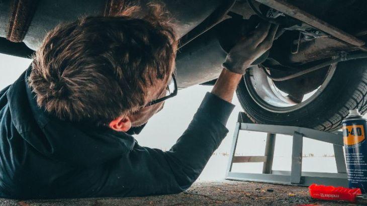 online payday loan man repairing car