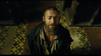 Valjean kneeling