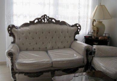 plastic covered sofa